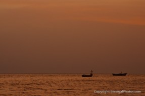 Fishing boats in a last light on the Atlantic ocean in front of village of Joal, Senegal. Photo by Marko Preslenkov.