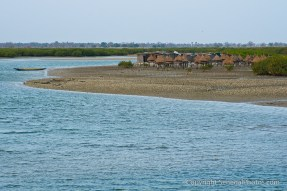 A bunch of huts on a deserted beach stretch in village of Fadiout, Senegal. Photo by Marko Preslenkov.