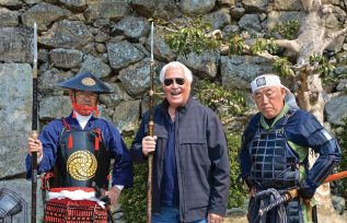 Weaponry and fearsome warriors defend Himeji Castle.