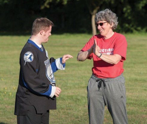 Chantal with athlete Robert.