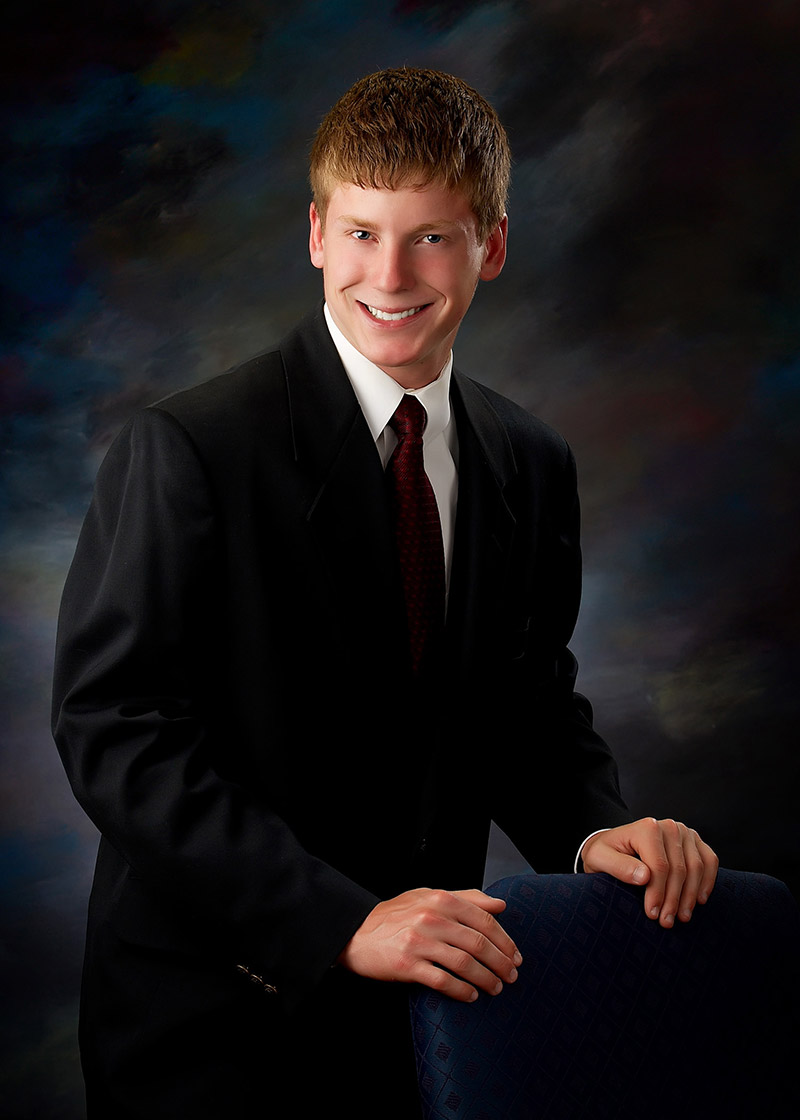 Formal senior portraits don't always have to be seated. Here is a boy standing for a half length formal portrait