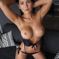 Kendra strips on couch