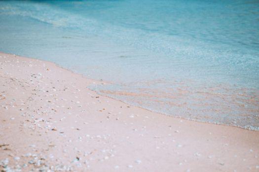 calm seashore with sand and aqua water