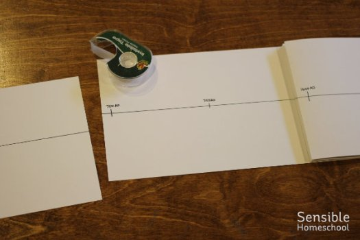 DIY history timeline assembly with tape