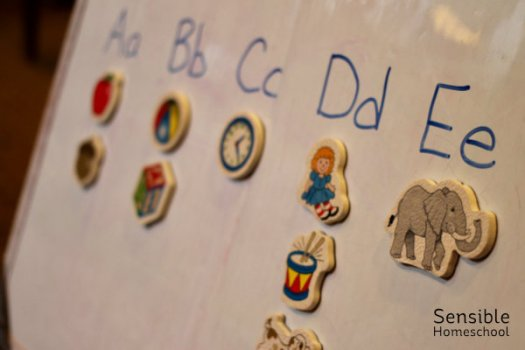 alphabet on whiteboard with matching picture magnets