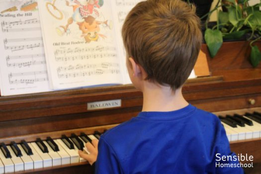 Homeschool boy practicing piano