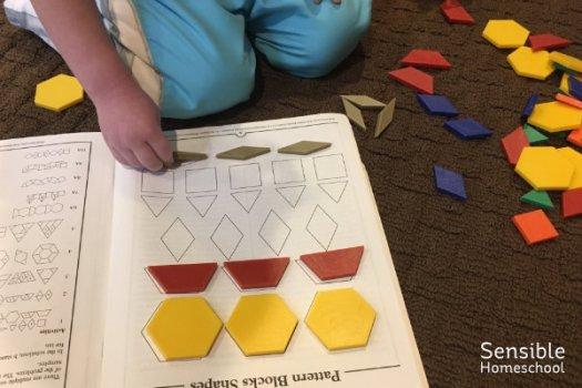 Homeschool preschooler working on Tanagram Shape book