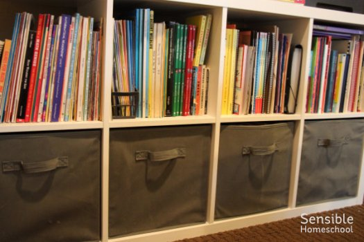 homeschool room curriculum shelves organized by subject
