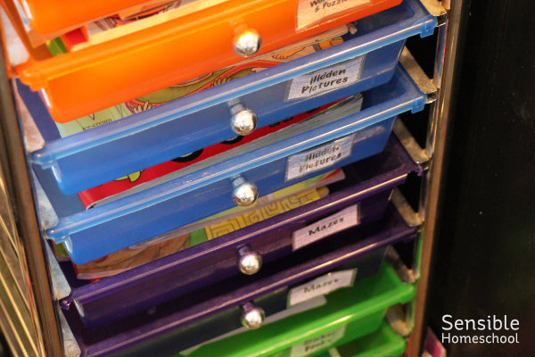 rainbow bins for homeschool kid's puzzle and maze book storage