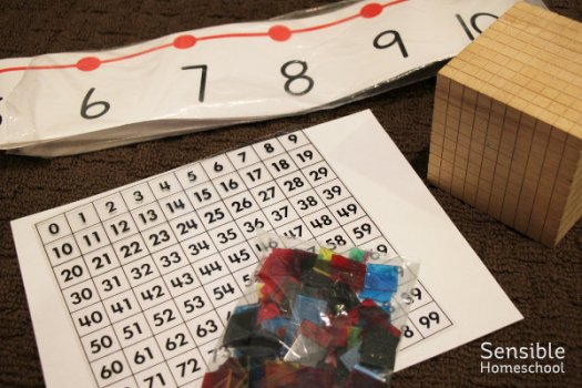 Homeschool number line, hundred chart with colored tiles and thousand cube manipulative