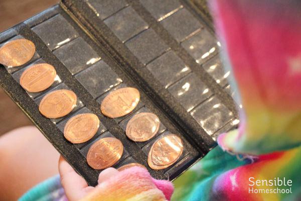 Preschooler holding collection of flattened keepsake pennies