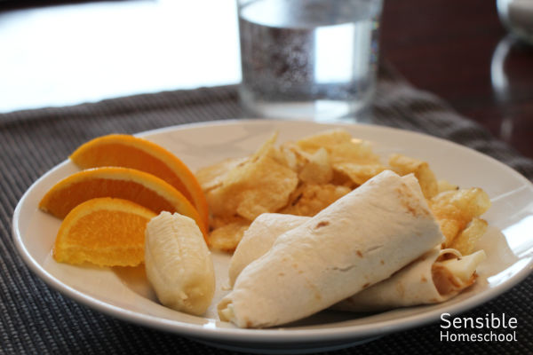 wrap, chips, fruit lunch plate