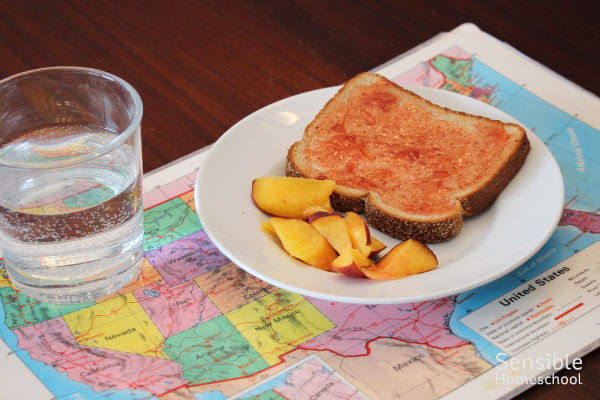 toast, peaches snack on kid's USA map placemat