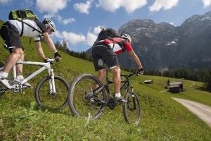 two bikers in the dolomite mountains by downhill