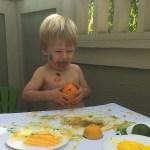 Josh painting with fruit
