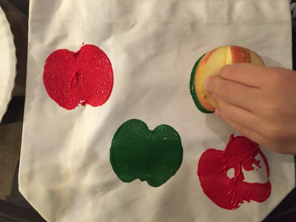 child making a painted bag