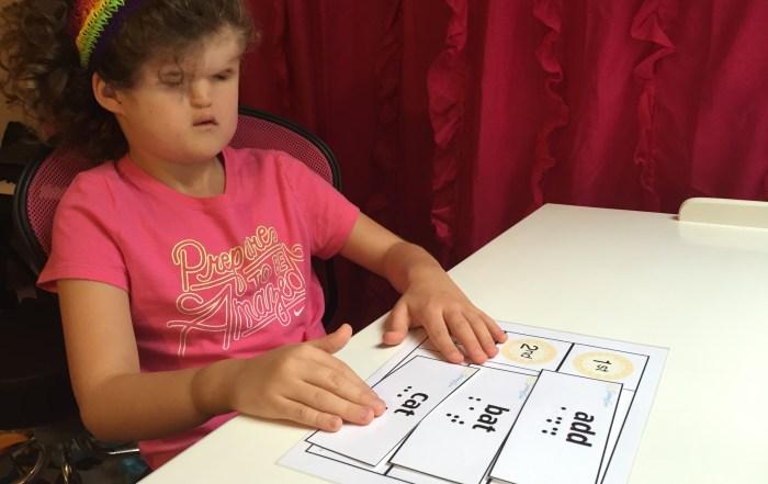 girl reading flashcards at desk