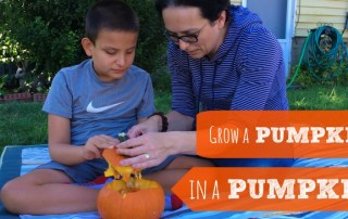 boy with his mom planting a pumpkin