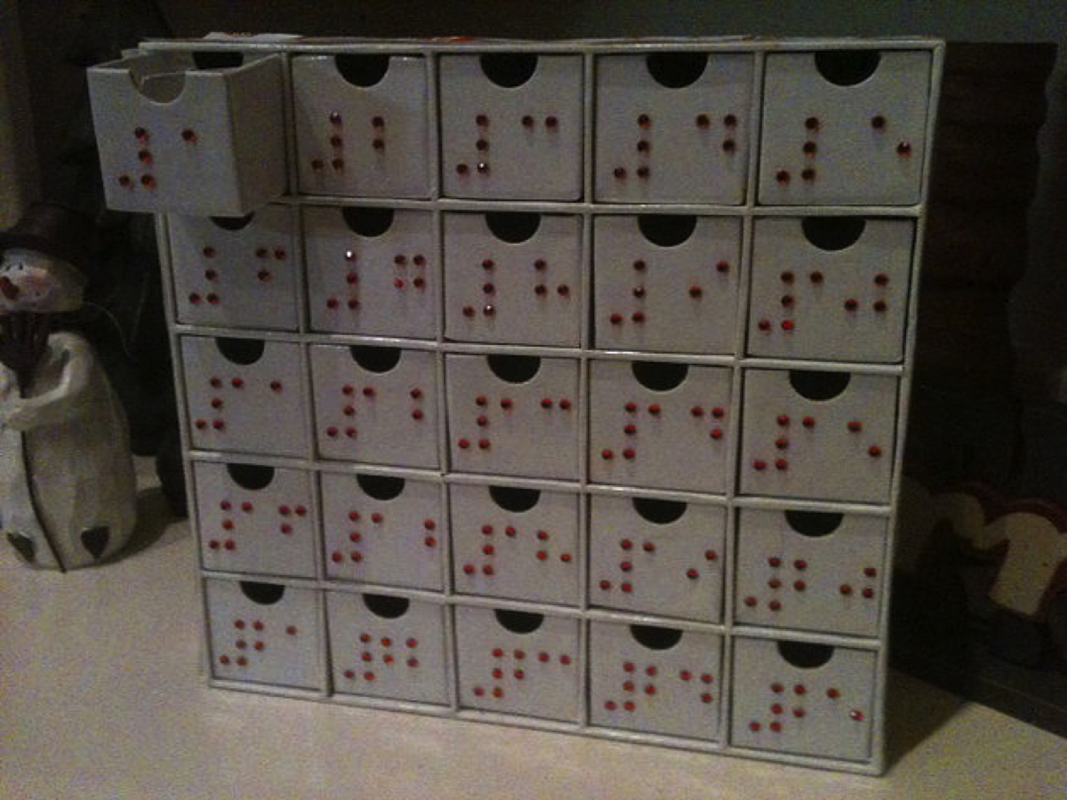 set of 25 small boxes with braille numbers