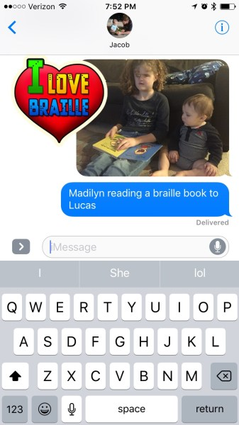 I Love Braille Sticker added to photo of girl reading braille book to baby