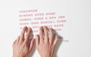 hands reading ELIA Frames tactile code