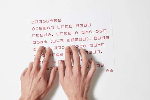 hands reading ELIA Frames tactile code