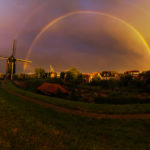 Heusden in de avond met een prachtige dubbele regenboog