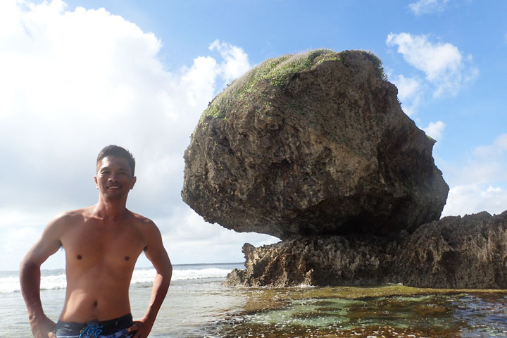 Behind me is the big rock from which the name Magpupungko came from.  It appears to be sitting on another rock formation. Pungko means squatting or sitting in the local dialect.