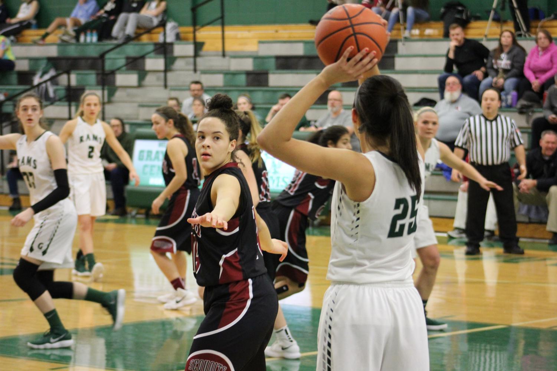 Junior Rachel Phillips defends against senior Ania Barnes.
