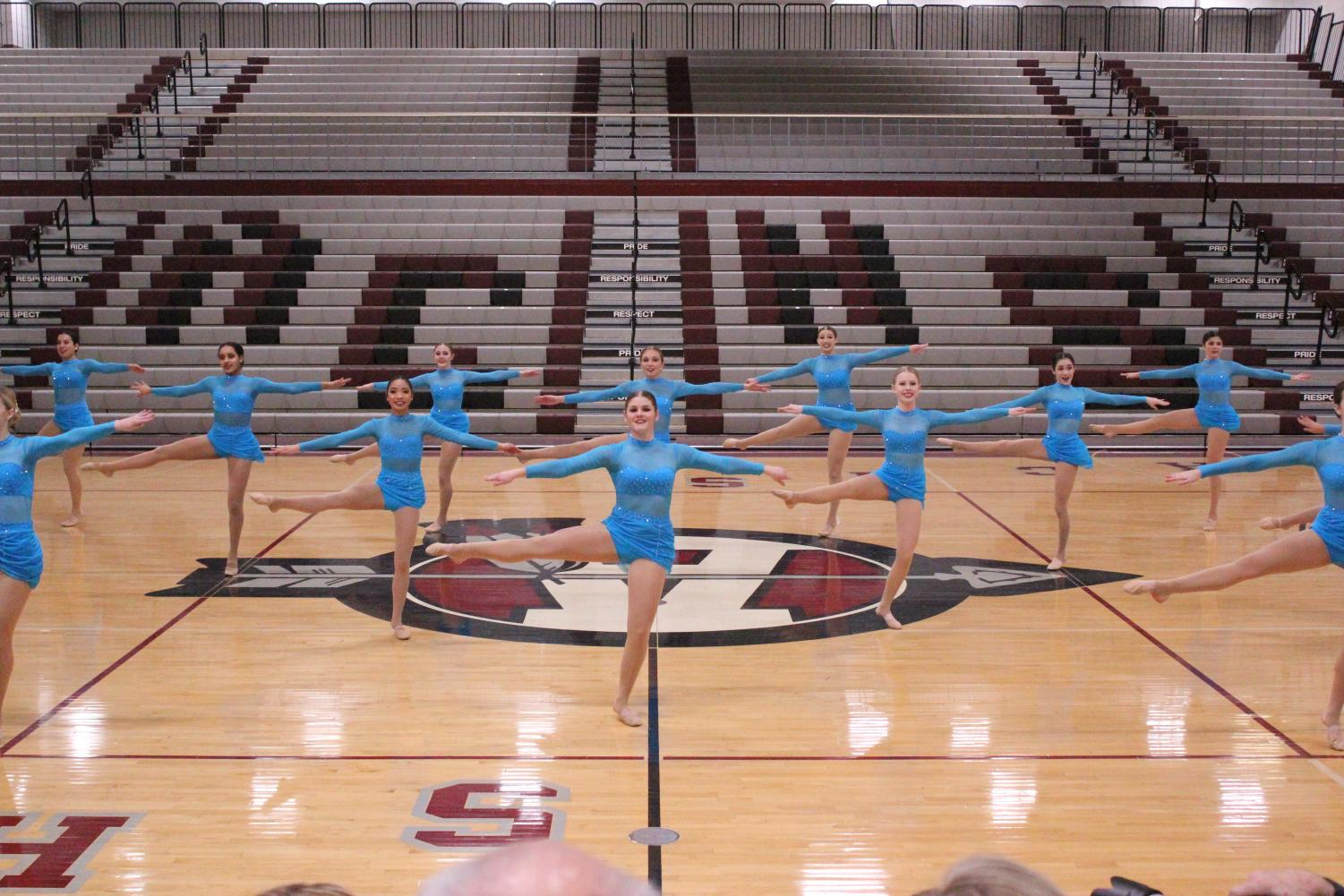 The varsity dance team performs at the NLCC conference championship