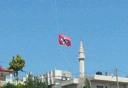 The Nazi flag proudly flies over the Arab Muslim village of Beit Omar, in Israel.