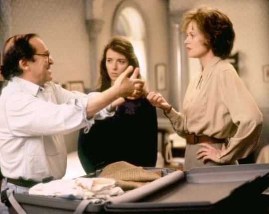 """Director Sidney Lumet works with Mia Sara and Melanie Griffith on the set of """"A Stranger Among Us."""""""