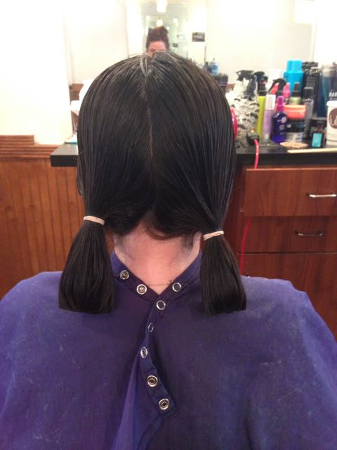 ... and donated her hair to a charity that fashions high quality wigs to cancer patients undergoing chemotherapy.