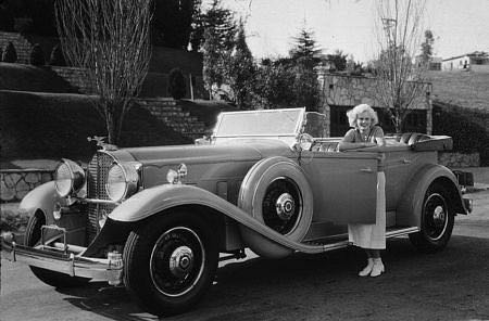 "Jean Harlow with her 1932 Packard. Harlow's two best movies are ""Red Dust"" ('32) and ""Bombshell"" ('33)."