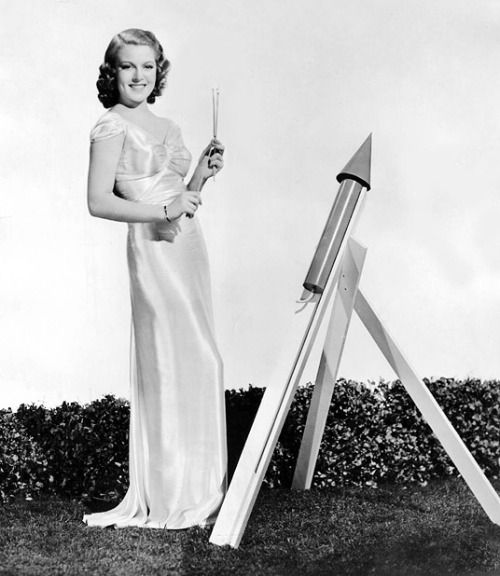 Lana Turner is about to ignite July 4 fireworks wearing a slinky gown. Do not try this at home.