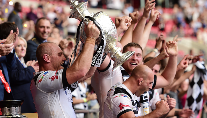Hull FC captain Gareth Ellis lifts the Ladbrokes Challenge Cup after Hull FC's 12-10 victory over Warrington Wolves at Wembley Stadium.