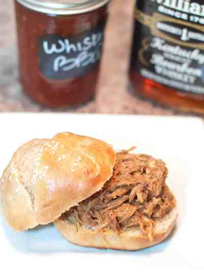 Slow Cooked From Scratch Pulled Pork Sandwiches! Homemade buns and a slow cooked pulled pork with a homemade whiskey BBQ sauce!