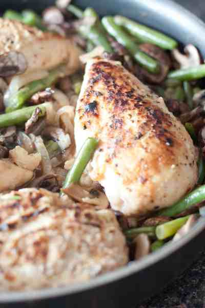 Everything you need in one pan: Green Beans and Mushroom Braised Chicken, a delicious and easy weeknight dinner.