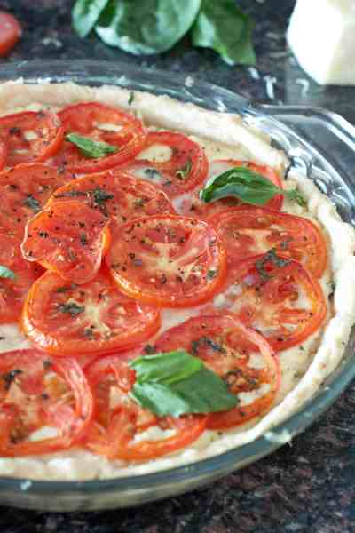 With fresh homemade ricotta cheese and a homemade pie crust, you can make a rich, savory Ricotta Tomato Pie From Scratch!