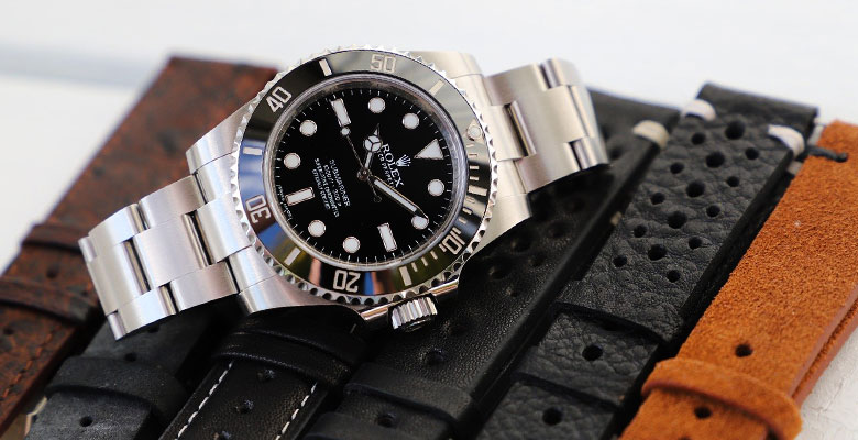 rolex lying on various strap options
