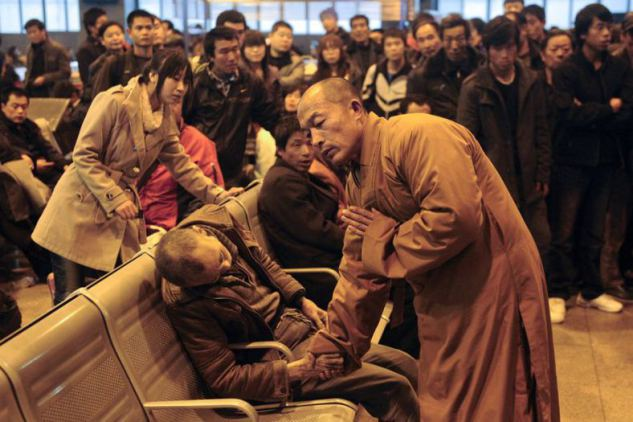 Buddhist Monk Blesses A Dead Man