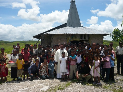 Fr. John and People of Sumba in front of Church by Haniesto