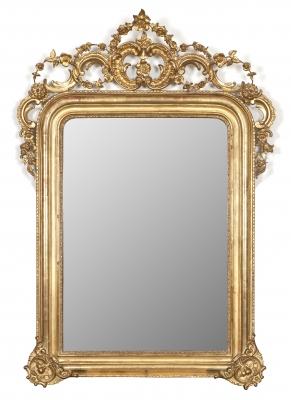 Espejo. Madera tallada y dorada.