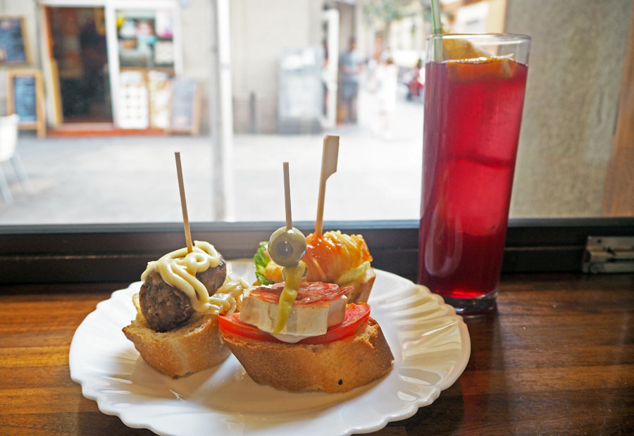 Pinchos with sausage, cheese & tomatoes and prawn, along with a glass of sangria.
