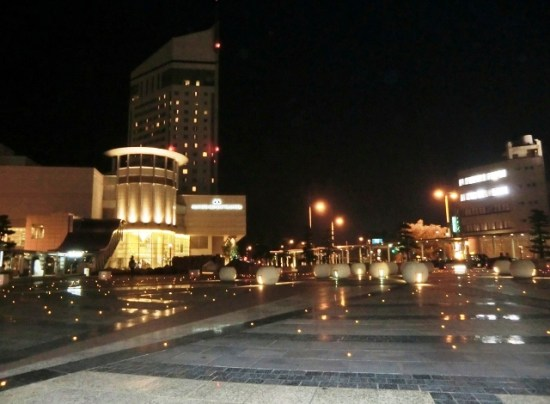 Takamatsu Sunport at night in front of the JR Station and Hotel Clement