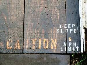Caution Deep Slope 5mph Limit