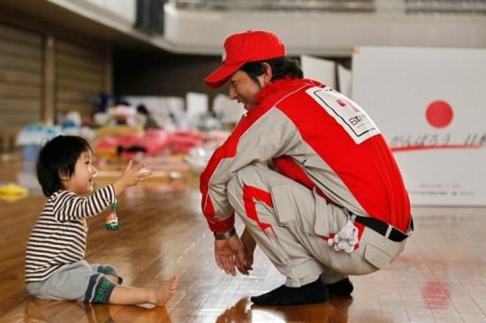 Rui Sato and a Red Cross Worker taken by Hiro Komae (Associated Press)