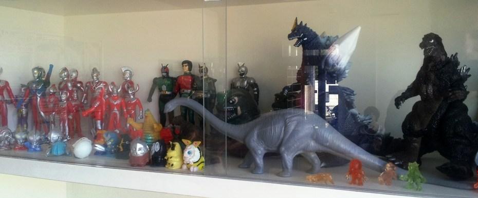 Ultraman, Godzilla and Dinosaur figurines on a shelf