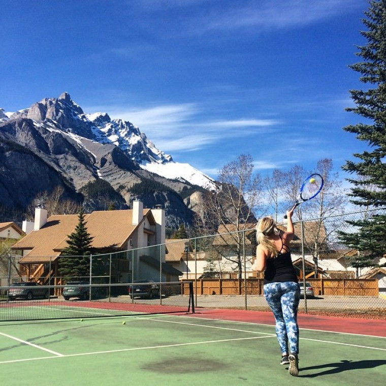 Playing Tennis at Banff Rocky Mountain Resort, banff
