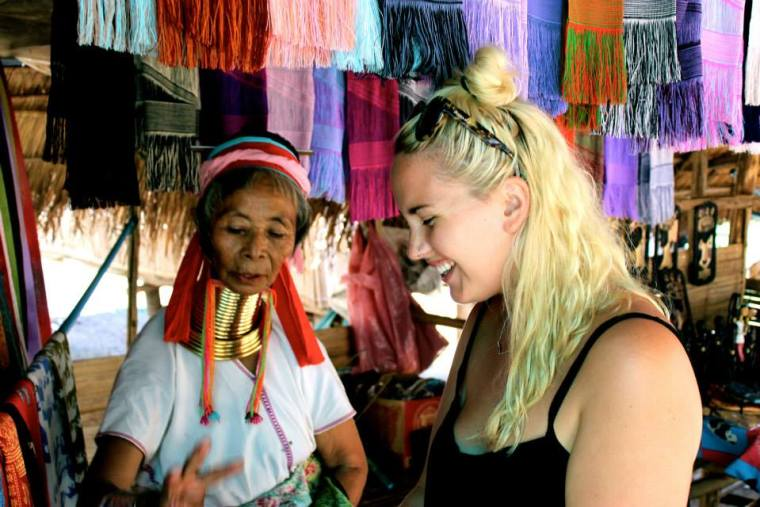 Buying a scarf from a lady of the Karen Hill Long Neck Tribe
